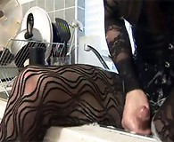 Zoe sits in her sink and soaps up her massive cock for a length wank.