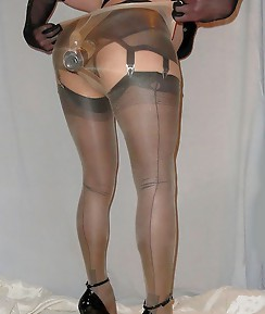 Crossdressers with big dicks making a creamy mess on their nylon stockings.