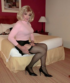 Various crossdressers showing off their hard cocks and very horny lingerie.
