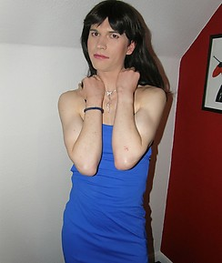 Pretty crossdresser wearing a sultry blue dress and showing her tight figure