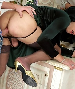 Filthy sissy in a green velour dress tastes meaty pole before ass drilling