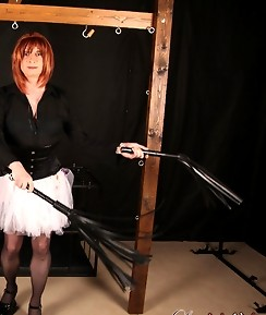 Lucimay is in the dungeon wearing a cheeky tutu and holding a crop