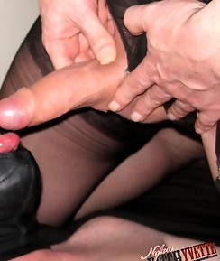 This masked gimp loves to suck two TGirl cocks at the same time