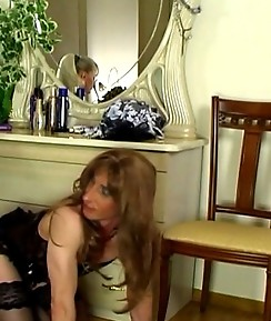 Corseted and stockinged pussy guy sucking and riding a hard strap-on cock