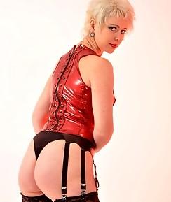 Mistress Helga loves to pose with her tranny sluts before she fucks them