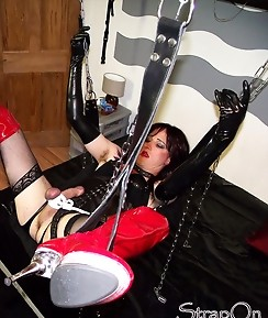 Strapon Helga knows how to dominate her tranny sluts in the dungeon